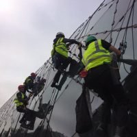 cleaning glass roof with rope access