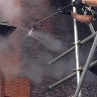 cleaning bricks with high pressure washing